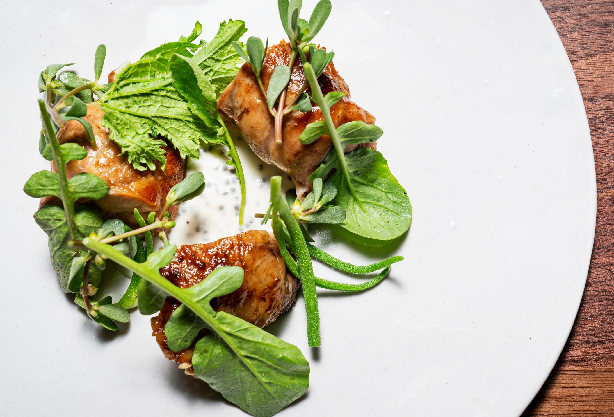 Sweetbreads, or organ meat, with spinach, bitter greens and paddlefish roe.