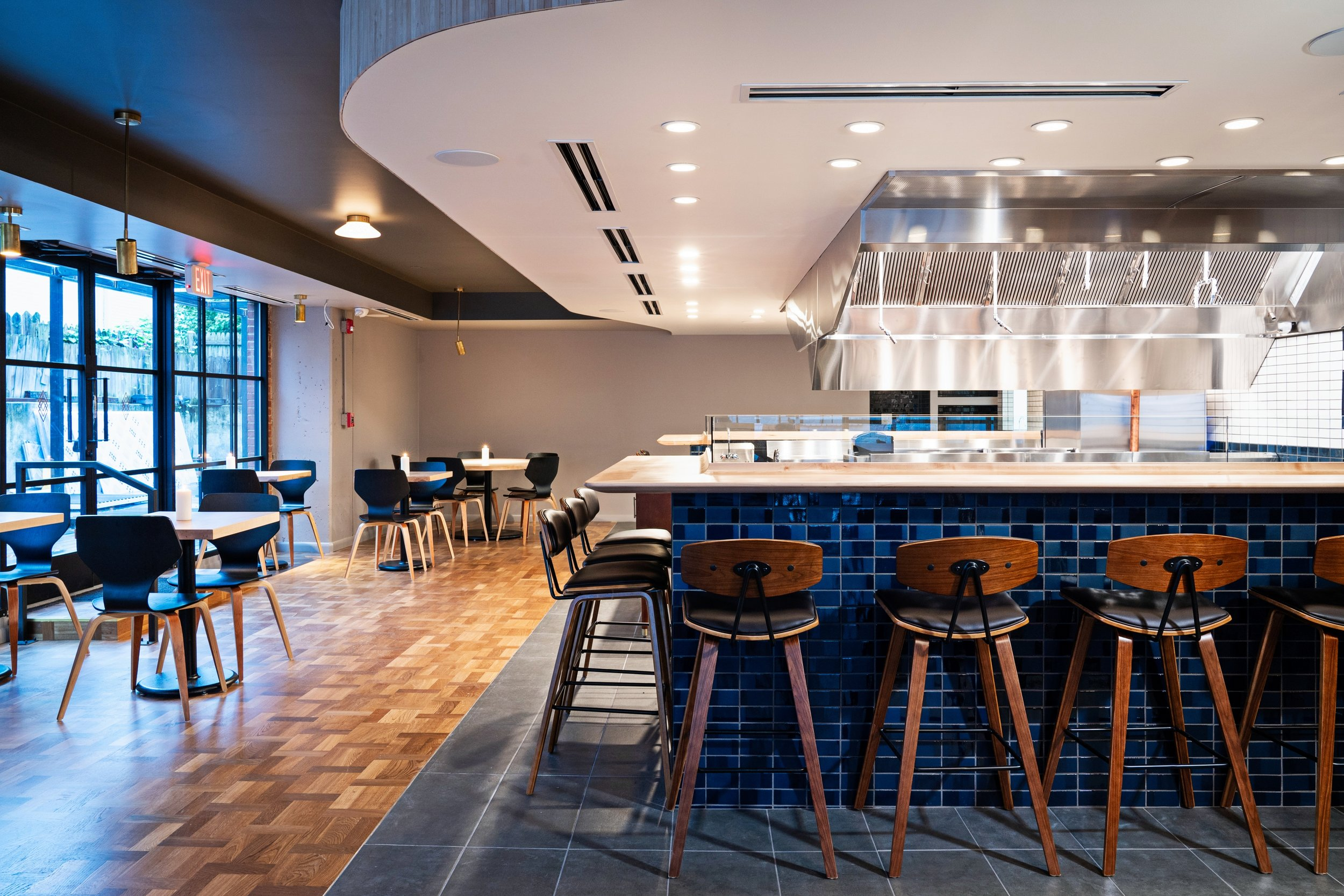 Diners can sit around open kitchen