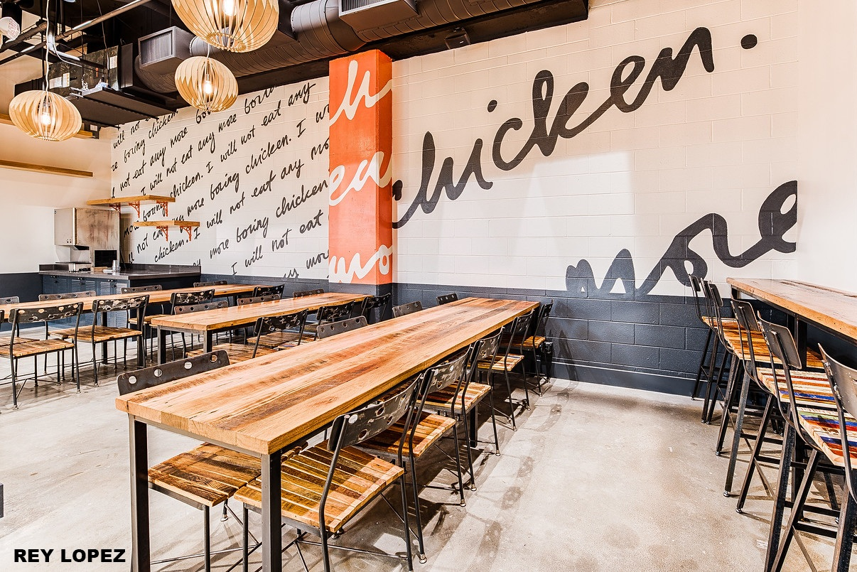 The wall reminds customers they won't eat boring chicken at Farmbird.