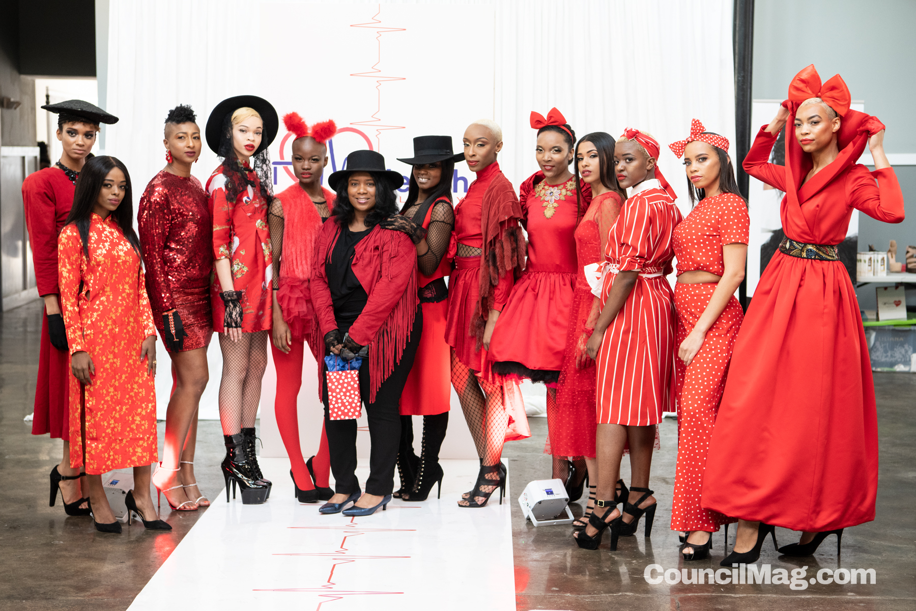 Virlé Cole's Red Collection by designer, Bettina Coleman, center.
