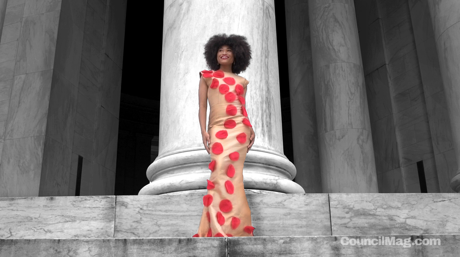 Model, Nina Larkins, displays Sam's high fashion couture line at the Jefferson Memorial.