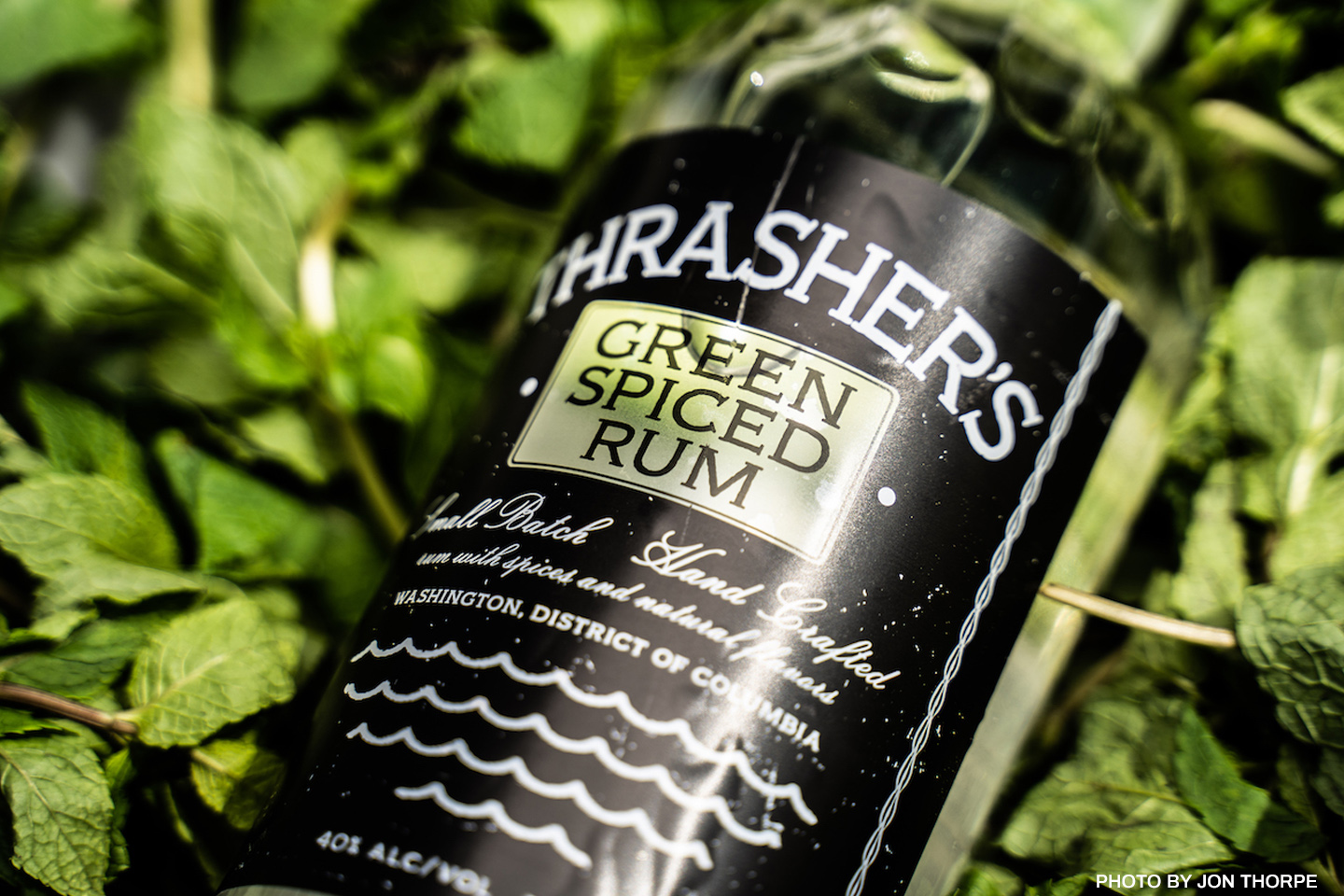 Thrasher's Green Spiced Rum is made with herbs grown in Todd Thrasher's backyard, including lemon verbena, lemongrass, lemon balm, mint and green cardamom, he said.