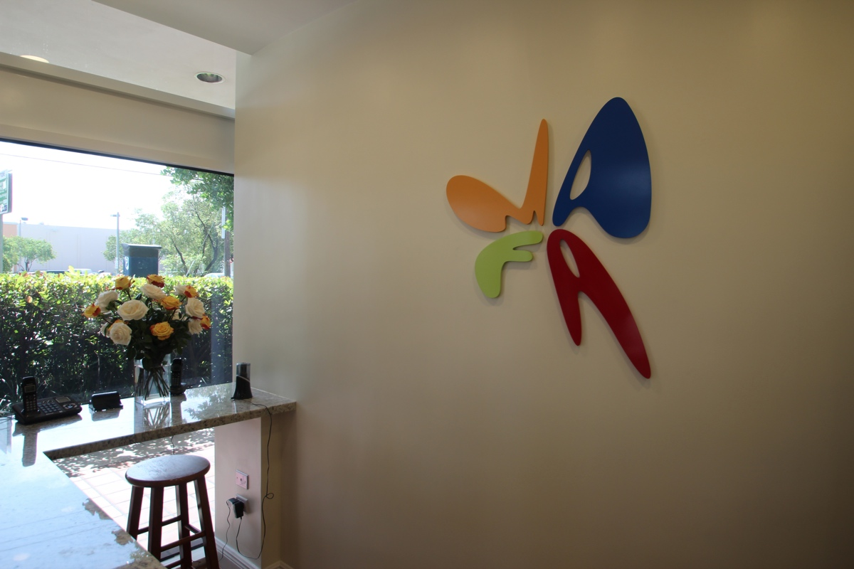 OUR COLORFUL LOGO WELCOMES YOU IN THE LOBBY