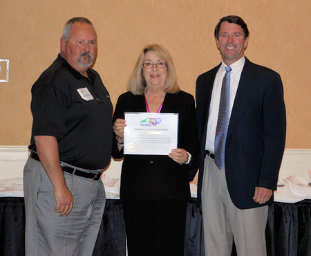 Pictured, from left, Andy Holliman, Cherie Berry, and Al Chesson at the Safety Awards Banquet.
