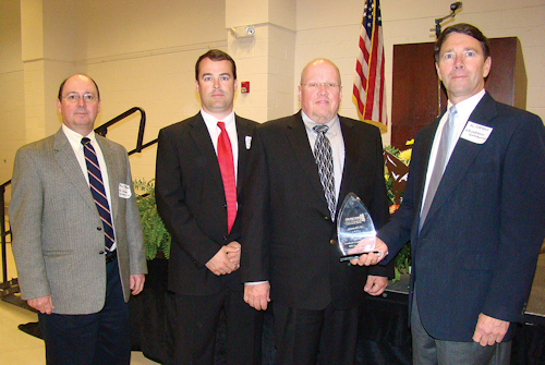 ACCEPTING THE AWARD ARE (LEFT TO RIGHT) DOUG CHESSON, ZACK MIXON, ED POWELL AND AL CHESSON. (PHOTO BY BRENDA MONTY OF THE ENTERPRISE)