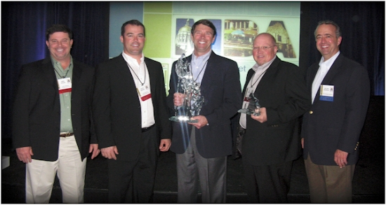 ACCEPTING THE AWARD AND ARTISAN CRYSTAL SCULPTURE FROM A. R. CHESSON CONSTRUCTION COMPANY, INC.   ARE (LEFT TO RIGHT) KIRK NIXON, ZACK MIXON, AL CHESSON, AND ED POWELL ALONG WITH   DELVIN WARNER, PRESIDENT OF METALLIC BUILDING COMPANY.
