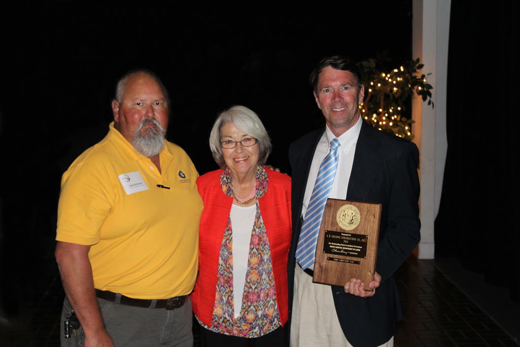 Pictured, from left to right, are Andy Holliman, Corporate Safety Director; NCDOL Commissioner Cherie Berry; and Al Chesson, President.