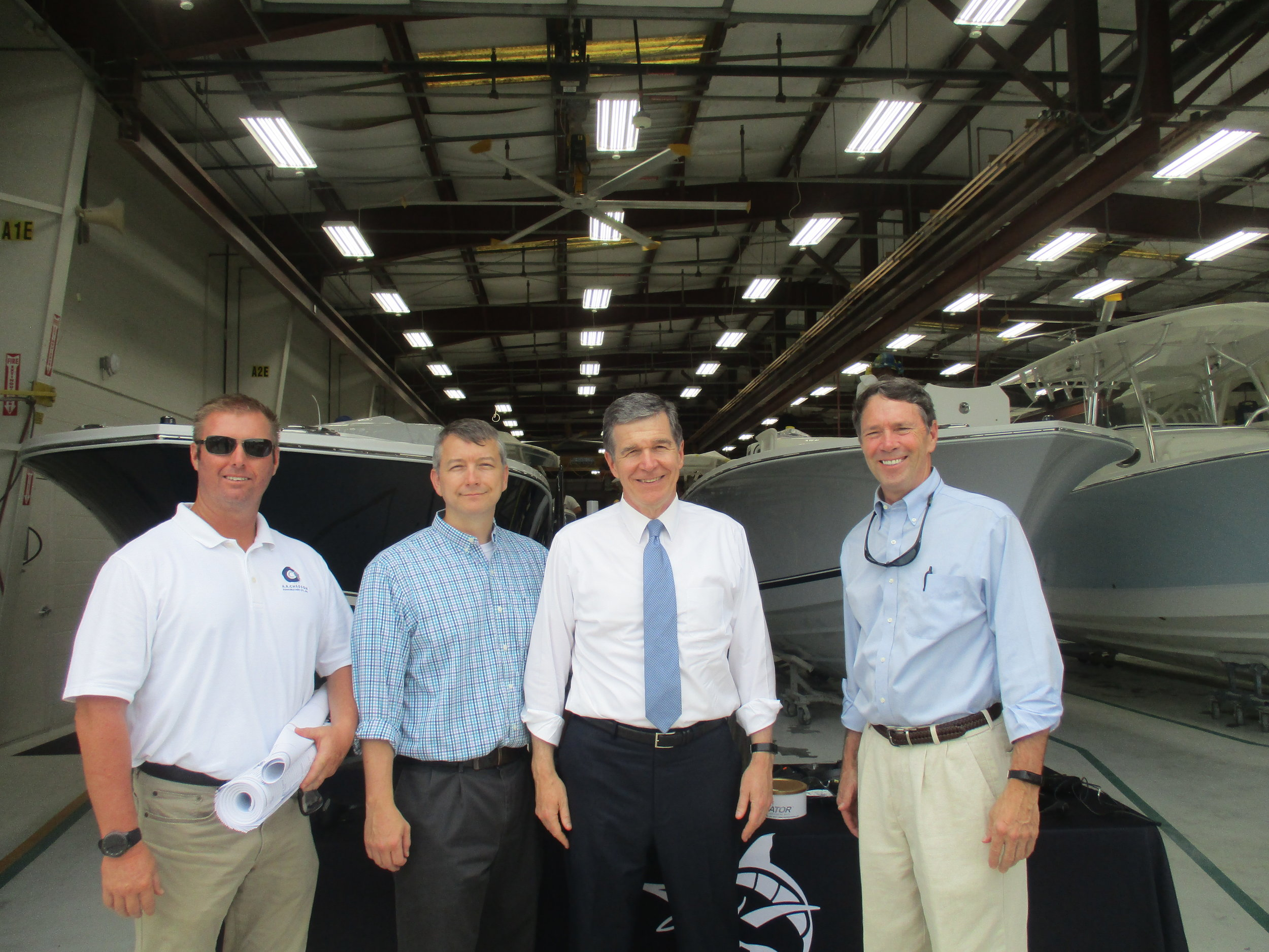 Pictured left to right: Greg Evans, Site Superintendent; Mitchell Ayers, Designer; Governor Roy Cooper; Al Chesson, President of A. R. Chesson Construction.