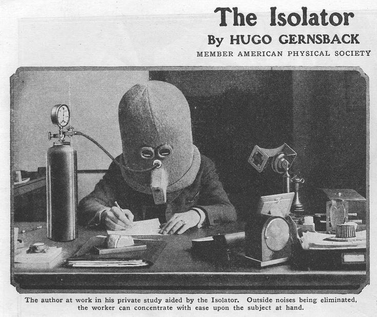 "Gernsback demonstrating one of his many inventions, ""The Isolator."" ""Outside noises being eliminated, the worker can concentrate with ease upon the subject at hand."""