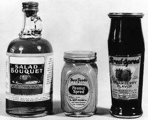 "The notorious Bred-Spred is on the right; the other foods shown here are an imitation vinegar and an imitation peanut butter, all sneakily seeking to avoid having to bear the stigma of ""imitation"" by using ""distinctive names."" Image courtesy the   FDA History Office."