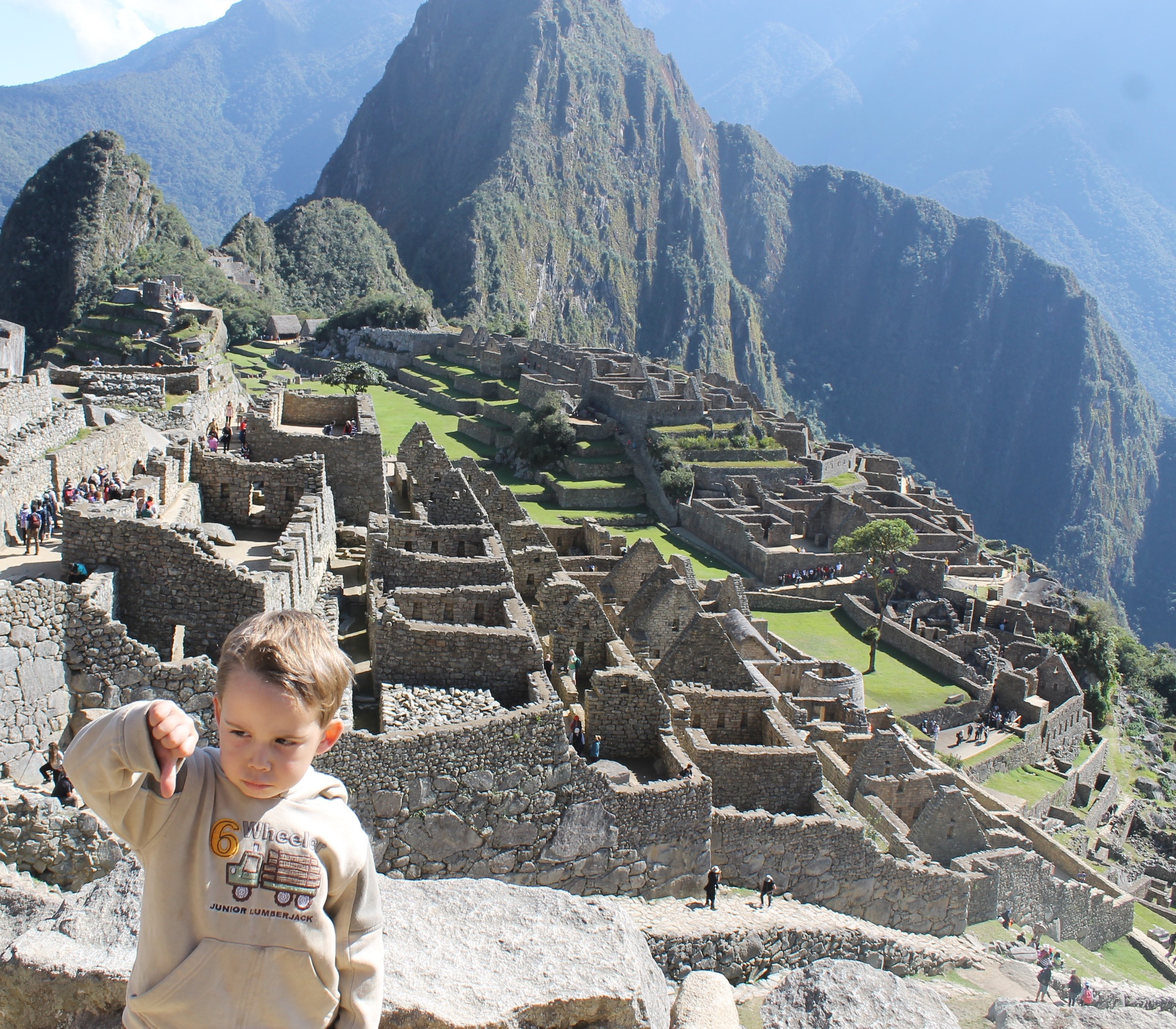 Kaleb's impression of Machu Picchu! He wasn't quite so impressed by all the walking around big stones and being hauled up the hills!