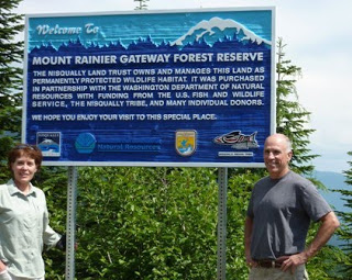Judy Scavone, Mount Tahoma Trails Association Board Member and Joe Kane, Nisqually Land Trust's Executive Director at the Mount Rainer Gateway Reserve, near the Copper Creek Hut. This newly acquired property protects nesting habitat for the marbled murrelet.