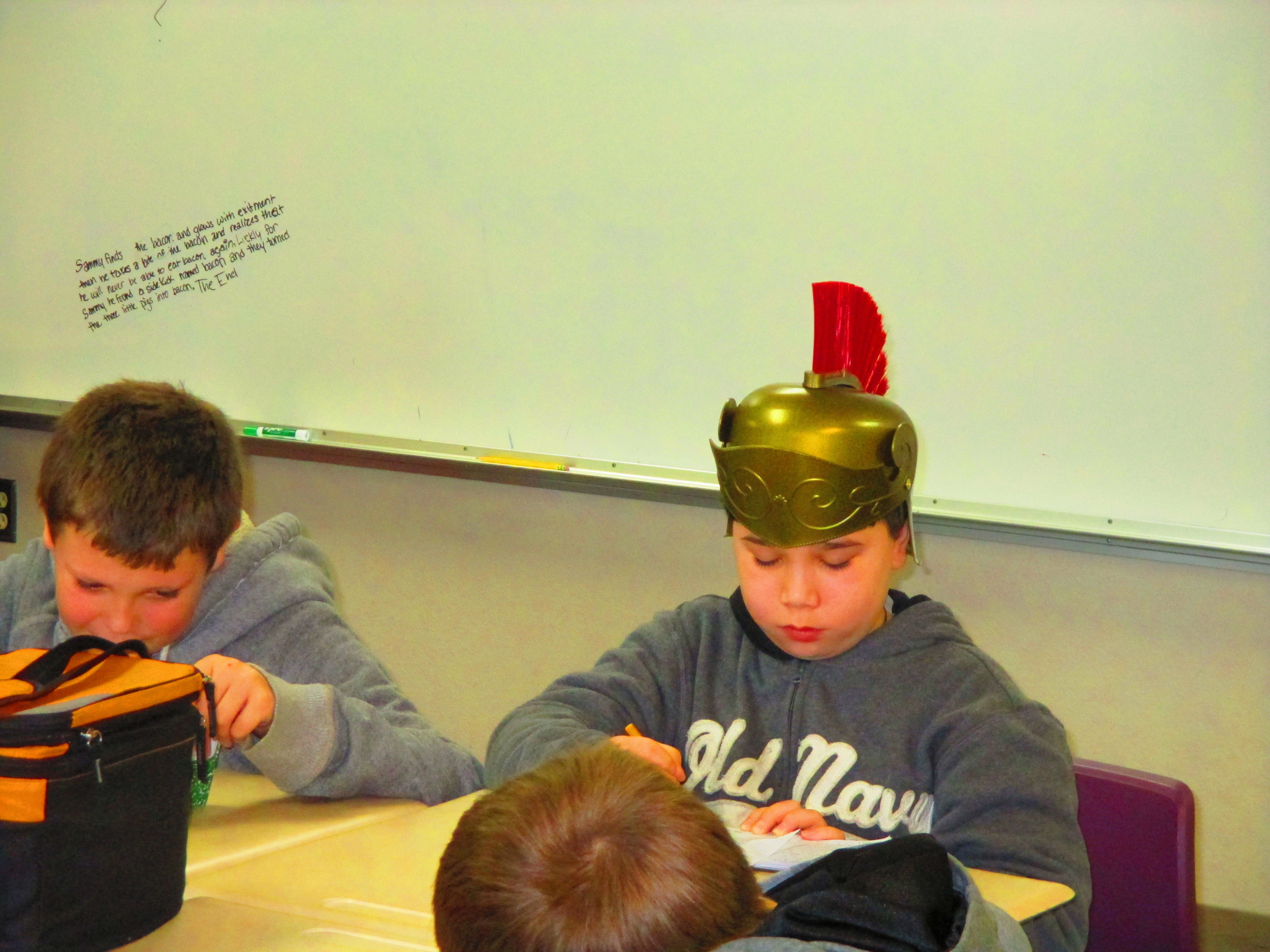 "The first student to finish transcribing the group story got to wear the warrior helmet. This studious warrior continued working--editing the story in his notebook. When I asked him how he achieved his victory, he said, ""I just did it."""