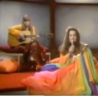 "Saving the best for last here...  PLEASE PLEASE click here  to watch Joni Mitchell singing her song ""Both Sides Now"" on the Mama Cass TV show in 1969. Perhaps unwittingly, Mama Cass is wearing an outfit that shows her uncanny (or unwitting?) understanding of the sunlight and visible spectrum ;)"