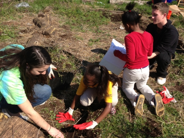 Members of Fruitstrology helping local Philly children learn about urban farming