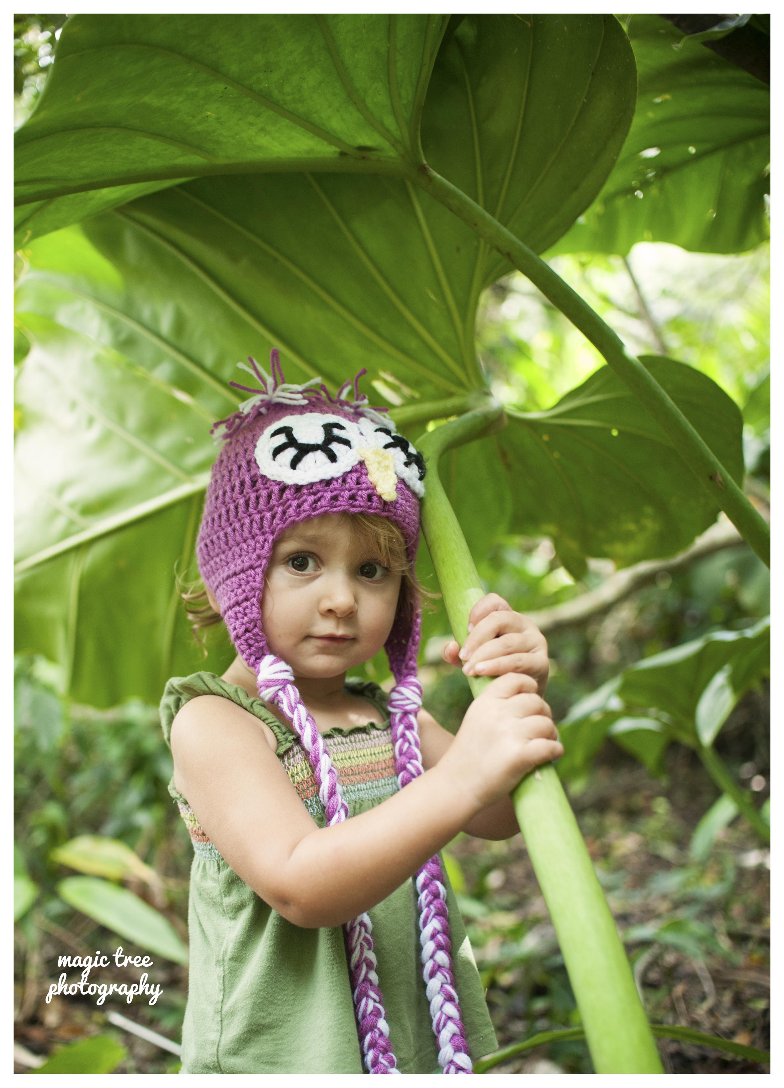 tashi in owl hat under elephant ear for web.jpg