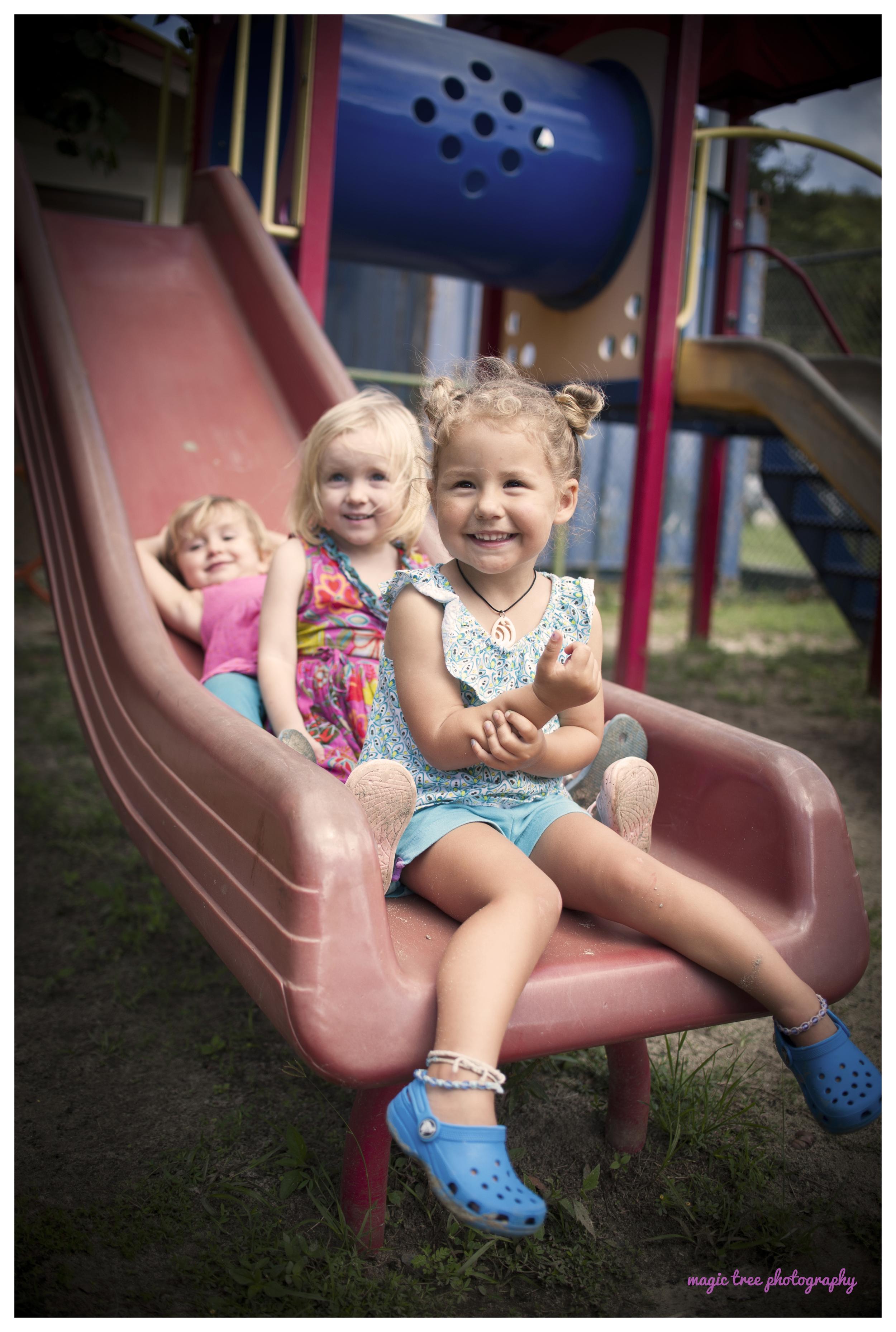 three girls on the slide for web.jpg
