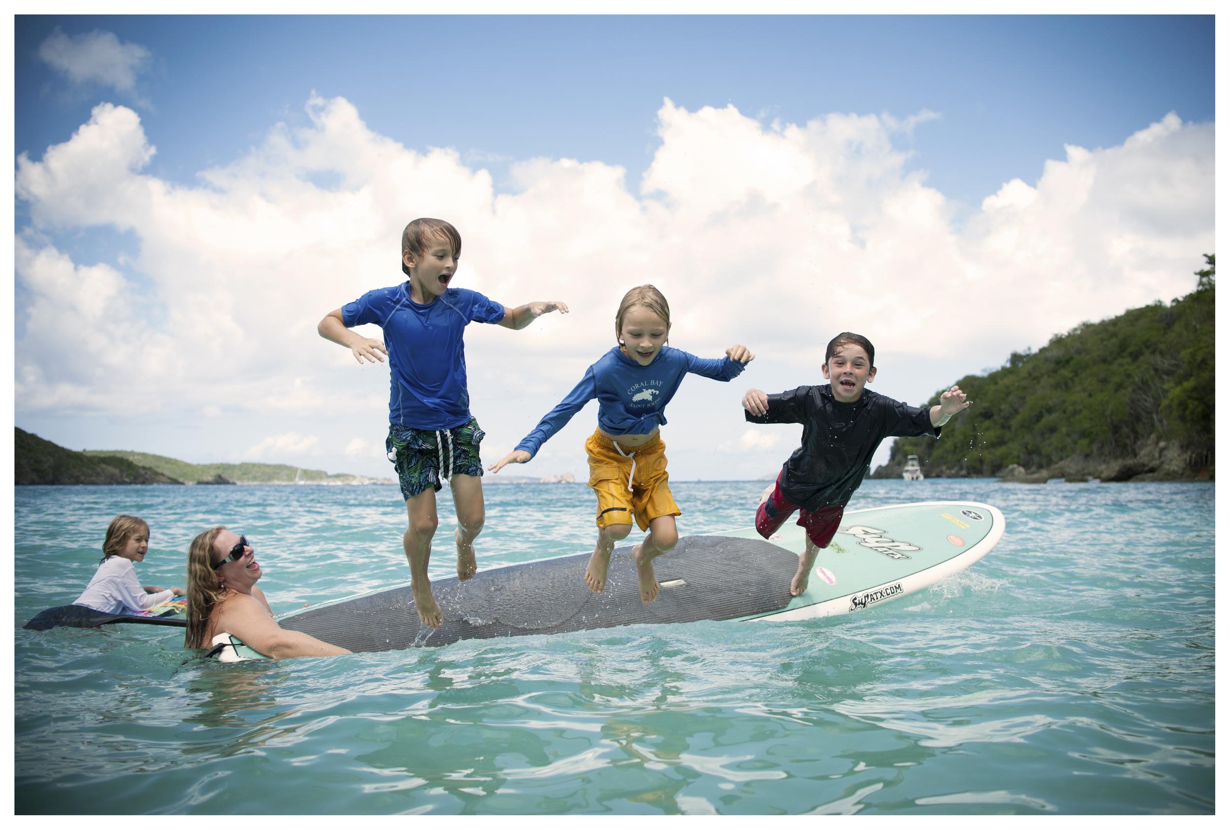 three boys jumping.jpg