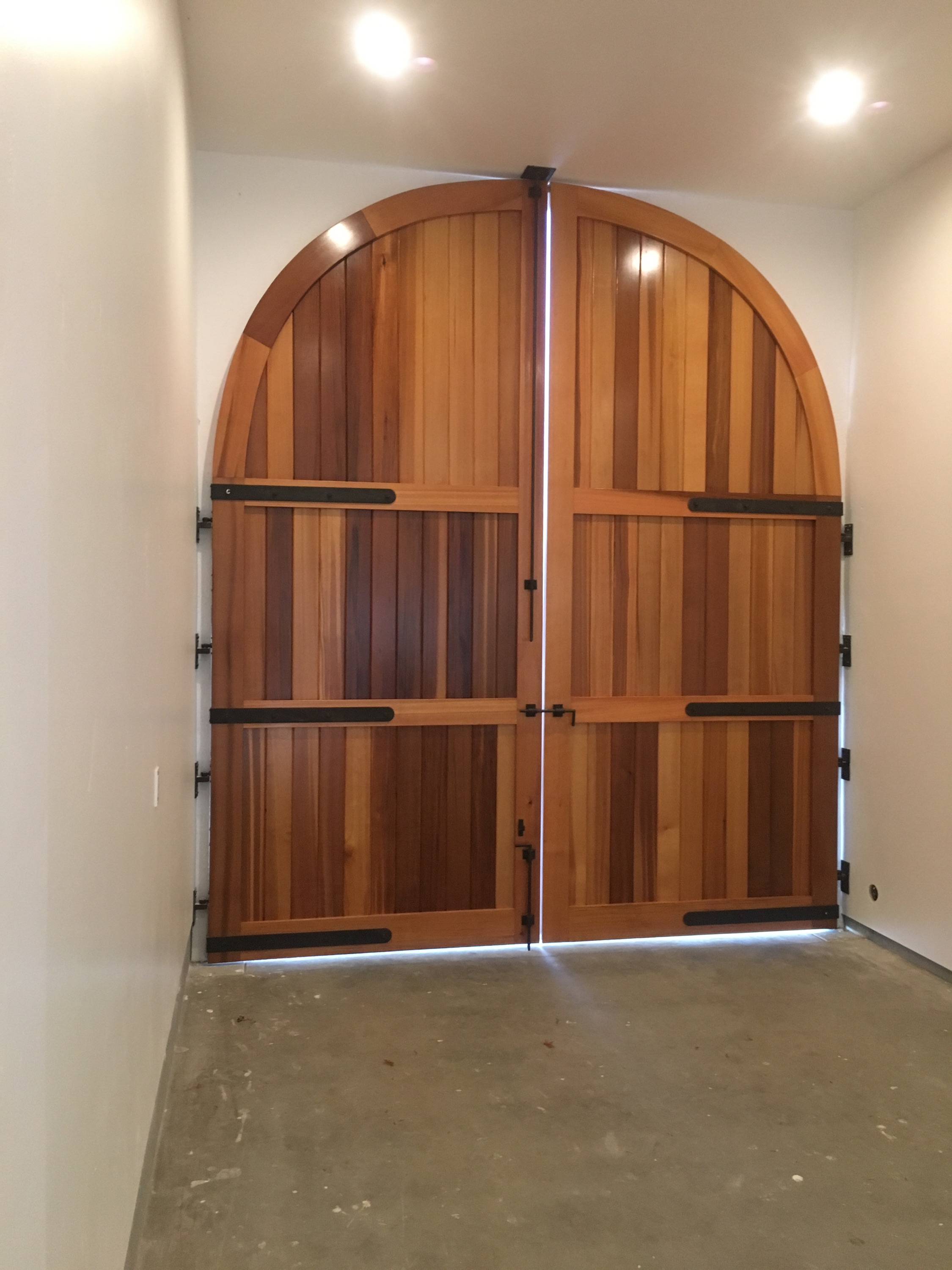 The doors from inside the garage, Shannon at Williams Gate Works really knows how to make beautiful doors. The hinges pivot off center to allow the doors to open completely flat against the interior walls.