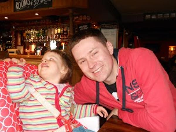 dominika and lukasz, out having a pint, somewhere in the UK, 2012