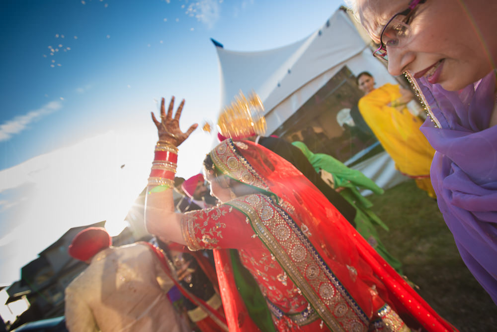 The bride throws phulian or puffed rice over her head. It means good wishes for her parents.