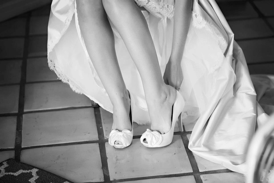 6. I know the gown isn't being featured, but Emily's shoe photo still made the cut in my book.  The gown is still captured in a fun way highlighting the hem, great shot from a shoe & hem perspective.  Just a little reminder to brides, that every moment of your Wedding Day is beautiful.    Photography:     www.stepintothelimelight.com