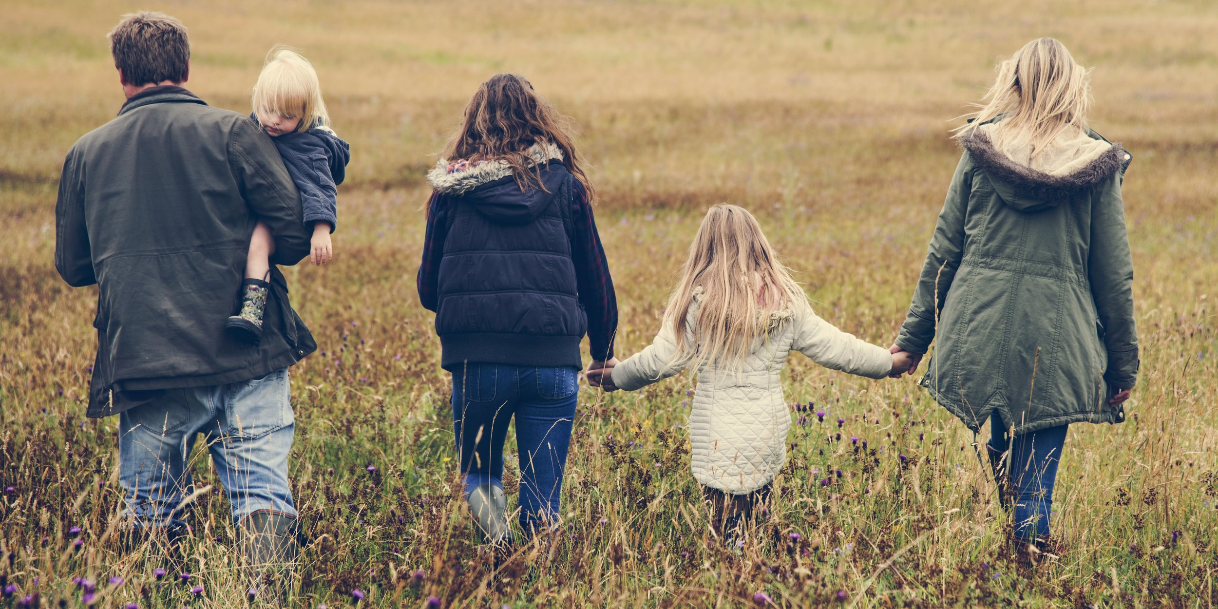 family-walking-field-nature-togetherness-concept-PZ8DSSM.jpg