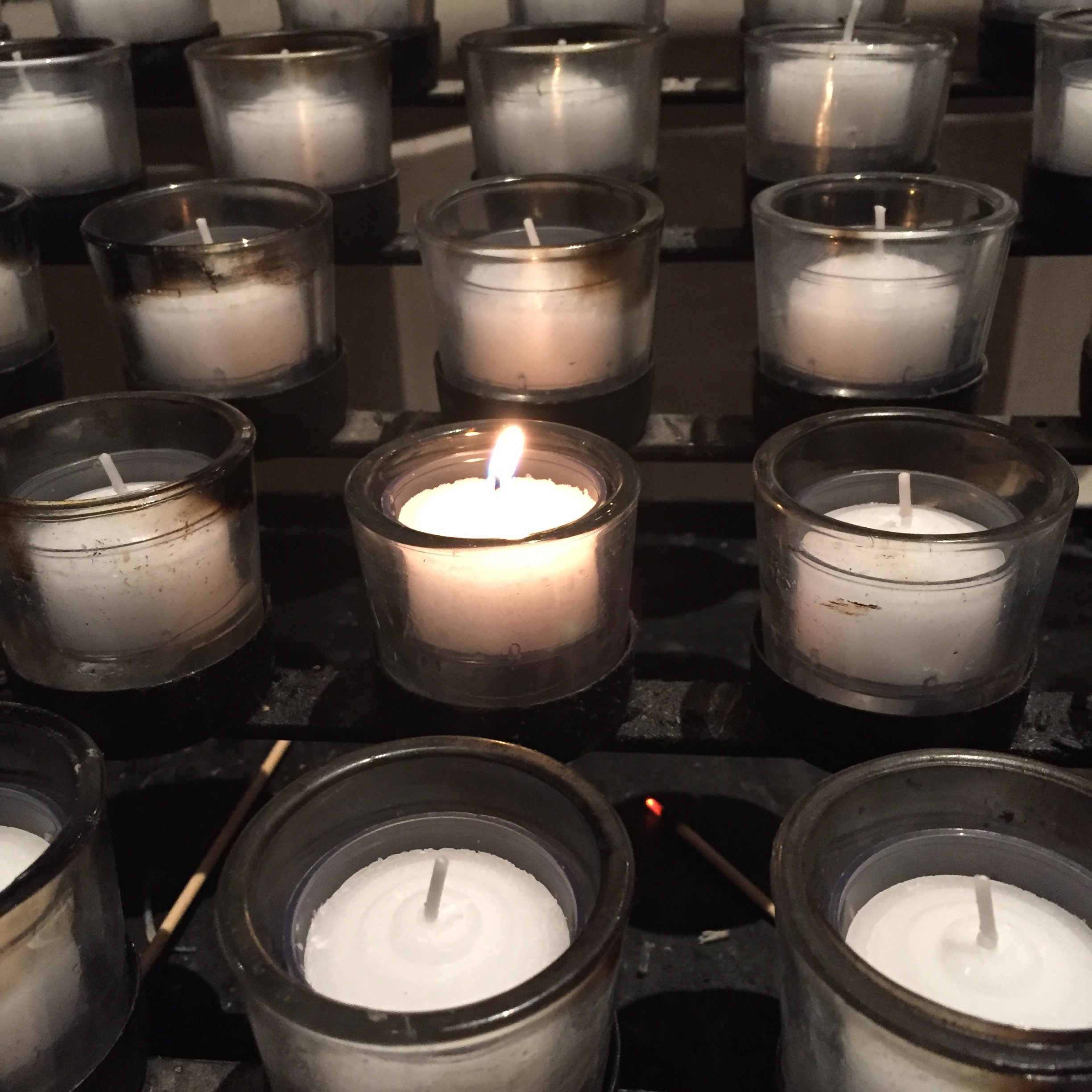 Photo of devotional candle stand at the Washington National Cathedral by Cassandra Marcella Metzger