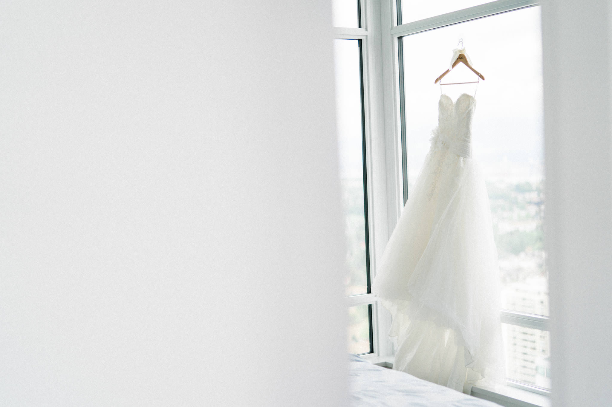Wedding dress hung by window