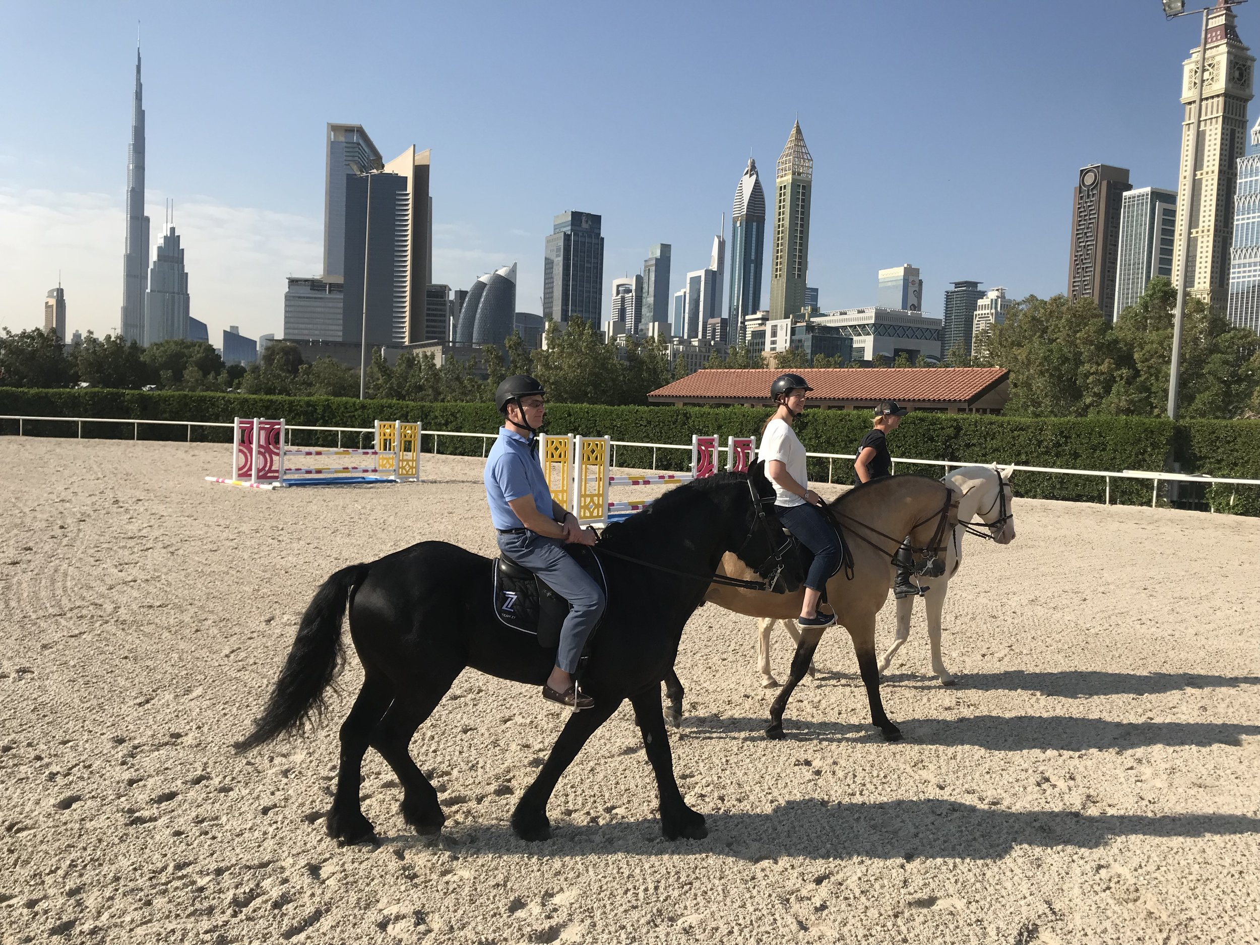 Mark, Chloe & Claire at Z7 Stables with the Skyscrapers of Downtown Dubai in the background