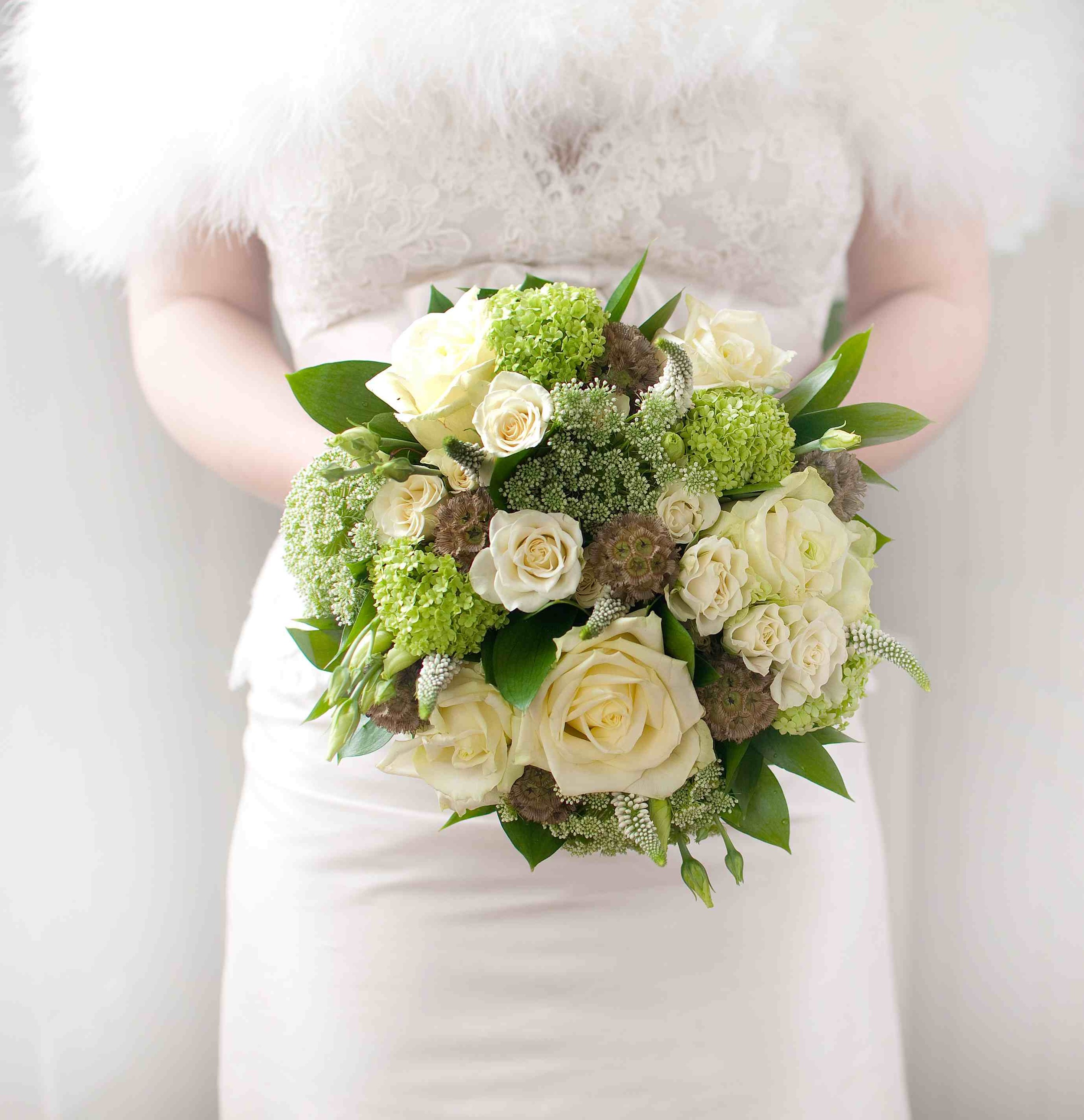 Green is a timeless colour for any wedding. Photo by  Cristina Colli  Flowers by  Budds Flower Design