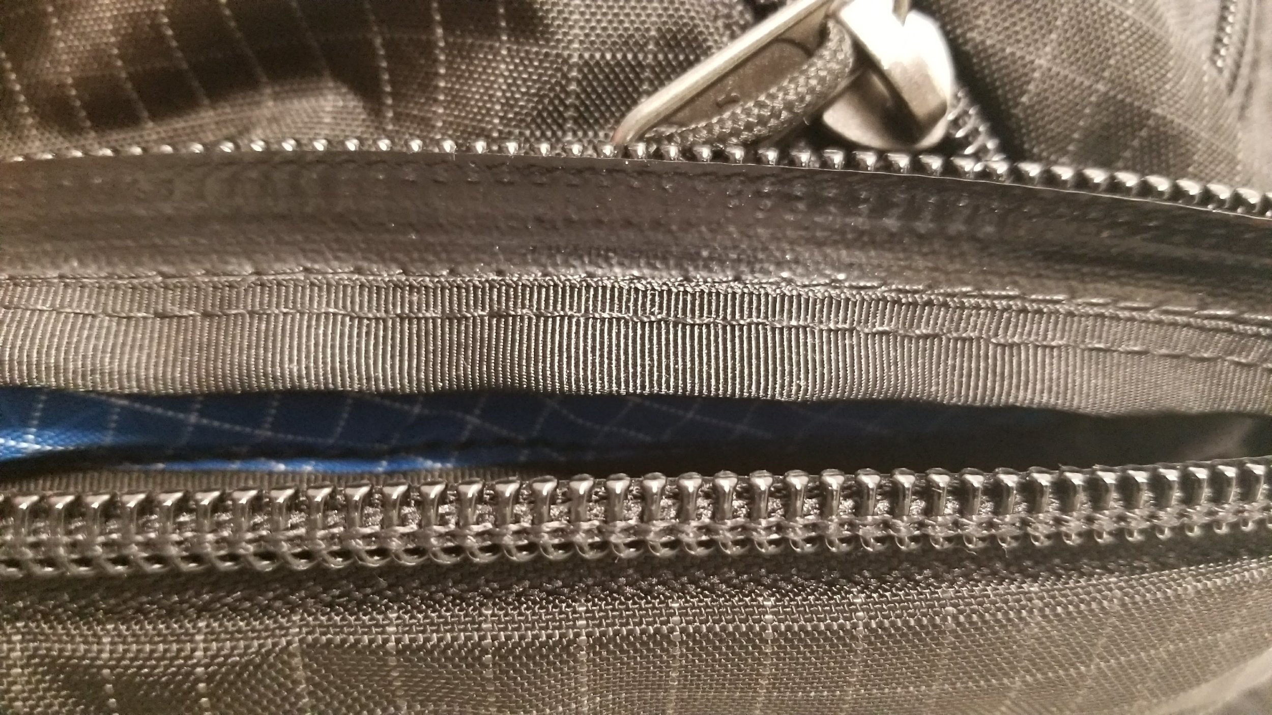 Color matched rubbery coating on the inside of the zippers.