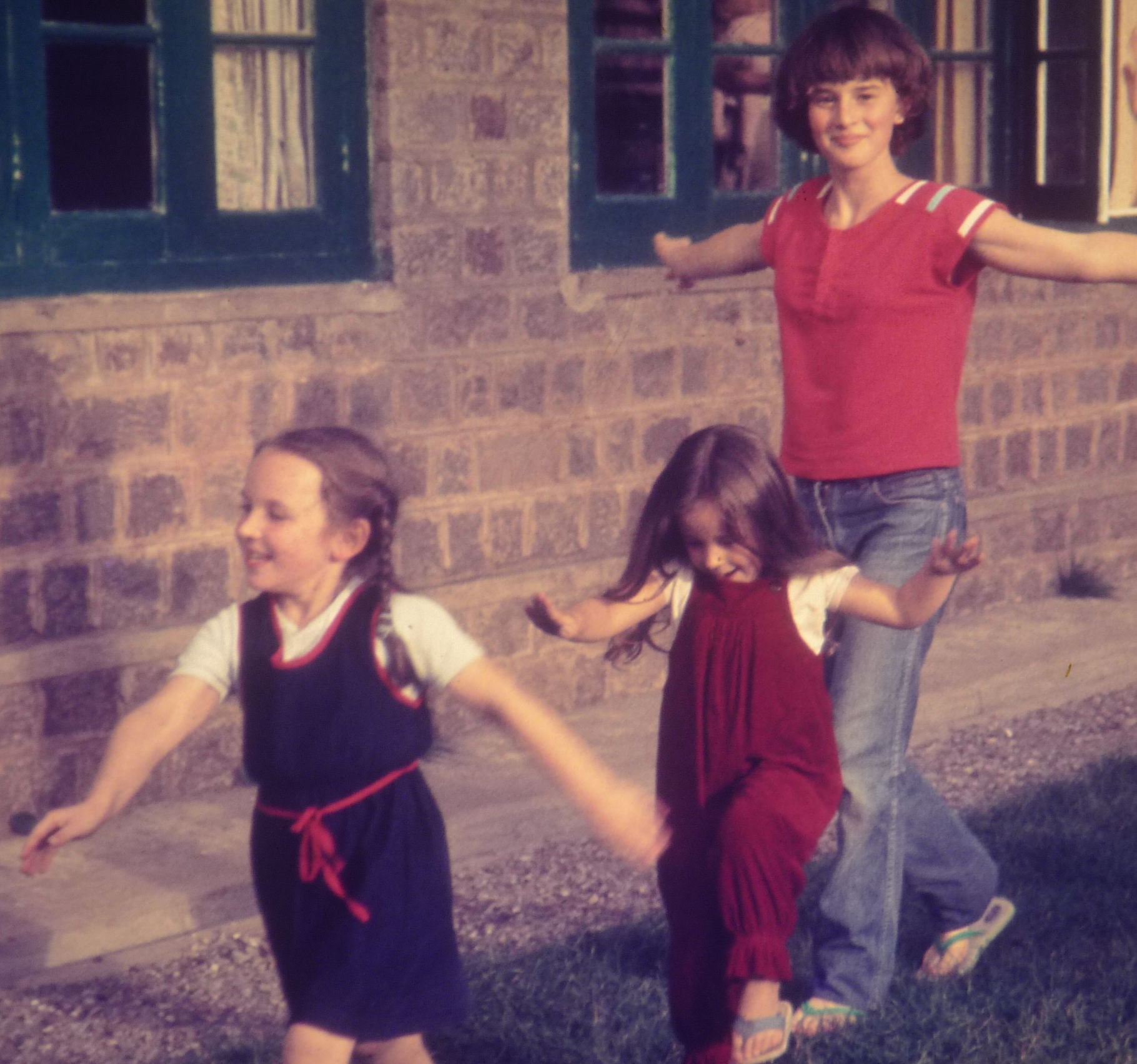 Yep, that's me in the red t-shirt at age 12, doing some babysitting and playing follow the leader.