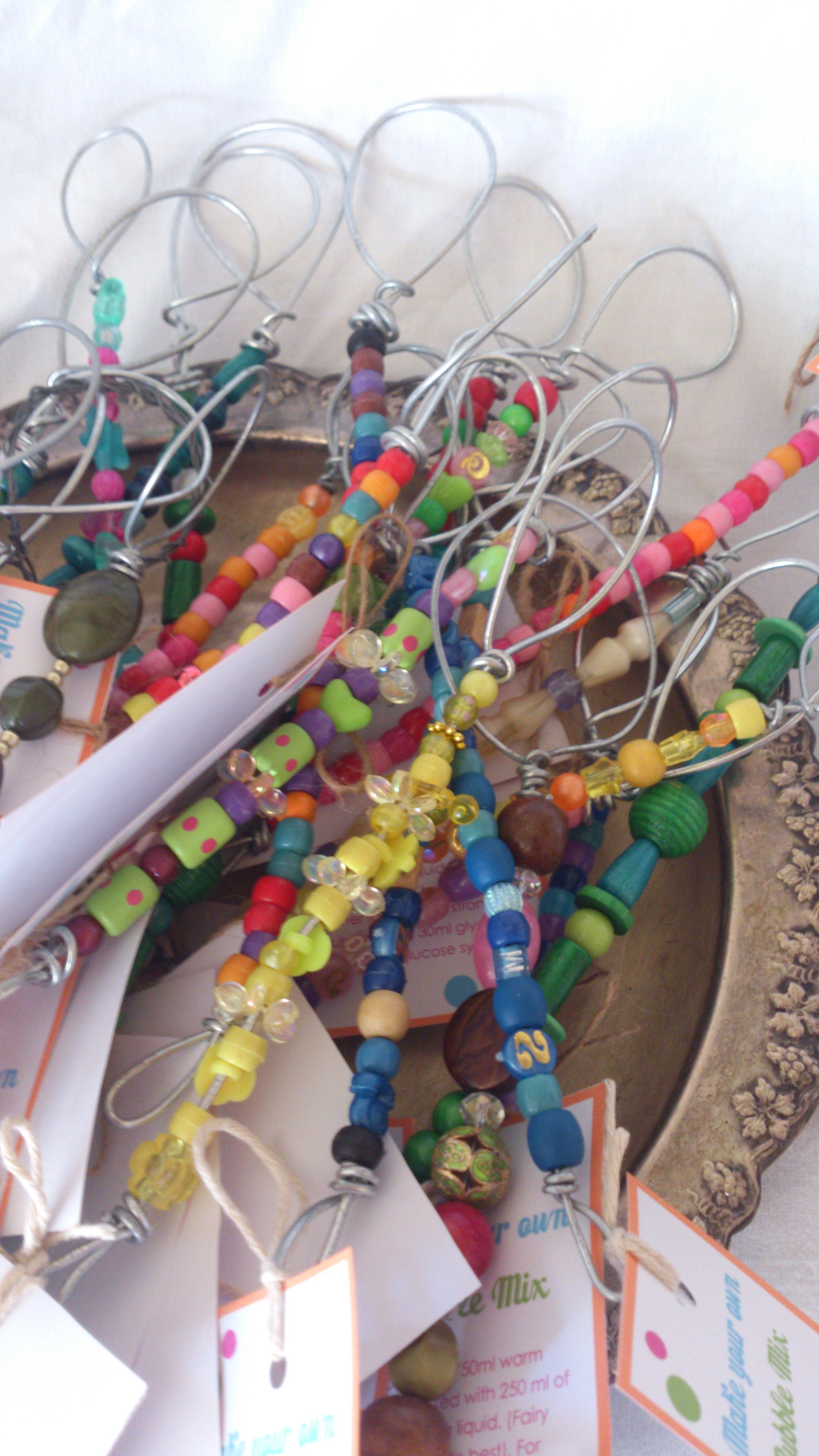 These are beaded bubble wands. Use a heavy duty wire and lots of colourful beads. Just be careful of spiky edges when you cut and bend the wire. I added a little card with a bubble mix recipe to each wand. Sadly, these didn't sell very well...