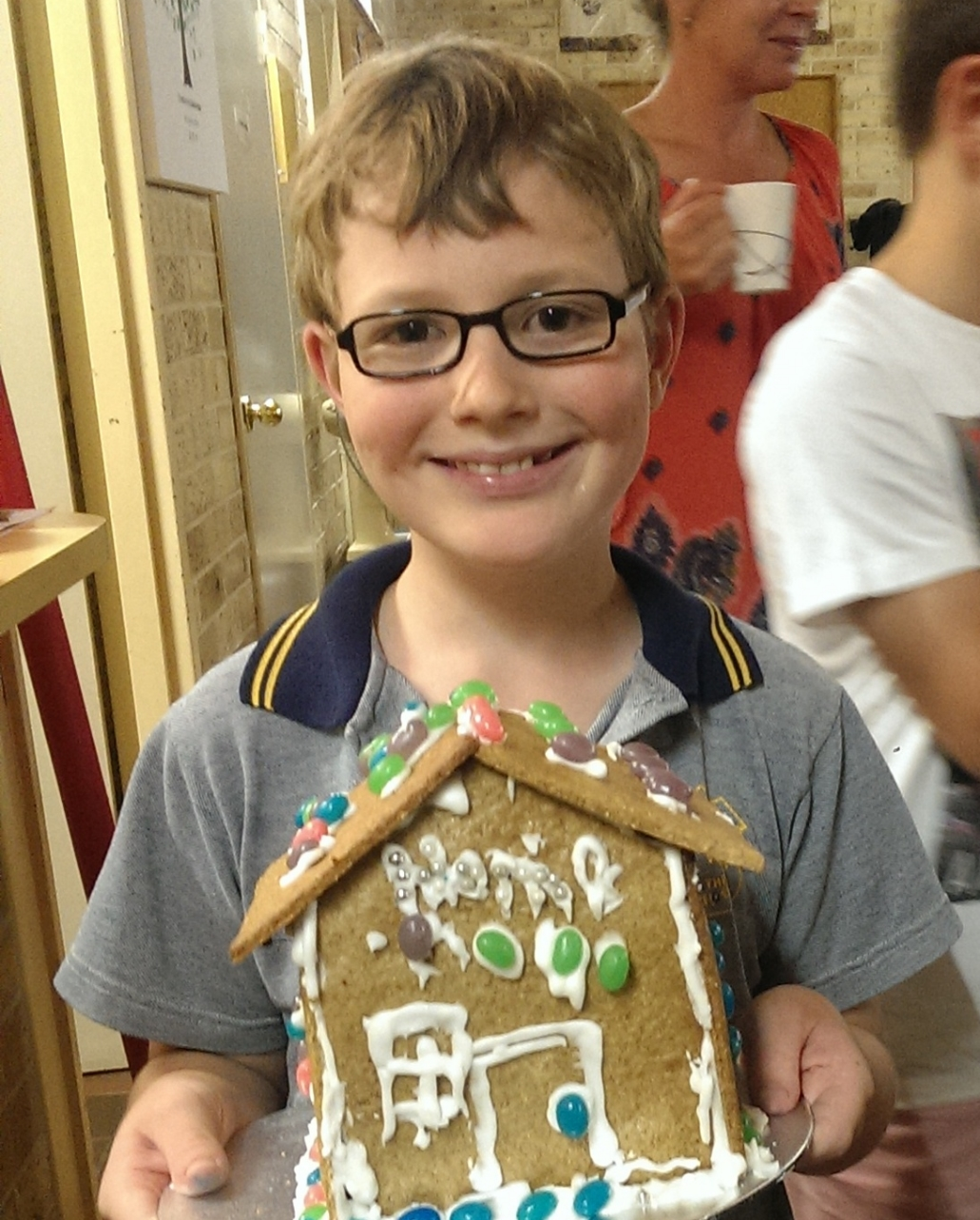 "Another first this year: he made his gingerbread house with everyone else at our GB House making night. ""Weren't you worried about the noise?"" I asked. ""Once I was doing it I was concentrating so hard that I didn't notice,"" he said."