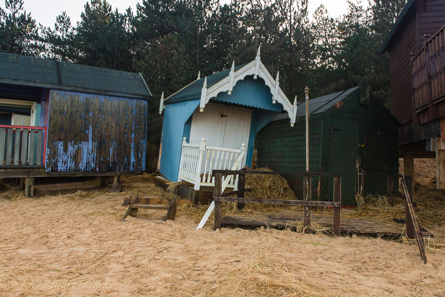 34-Beach hut moved by storm surge.jpg