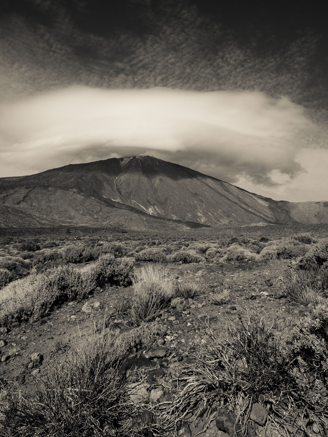 Turbulent cloud formations hover and swirl above Mount Teide.