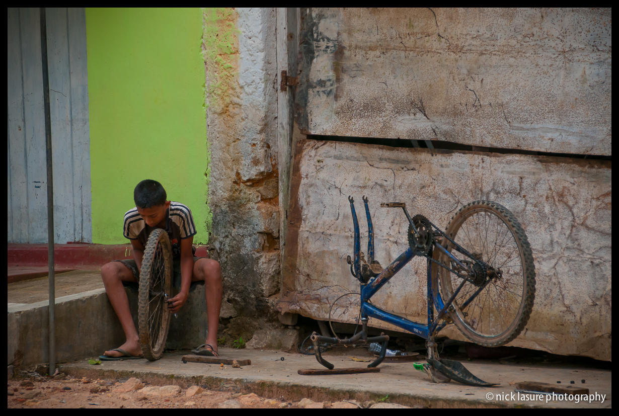 The Bicycle  - a young boy works on his mountain bike near the village of Ella, bit of a kindred soul.