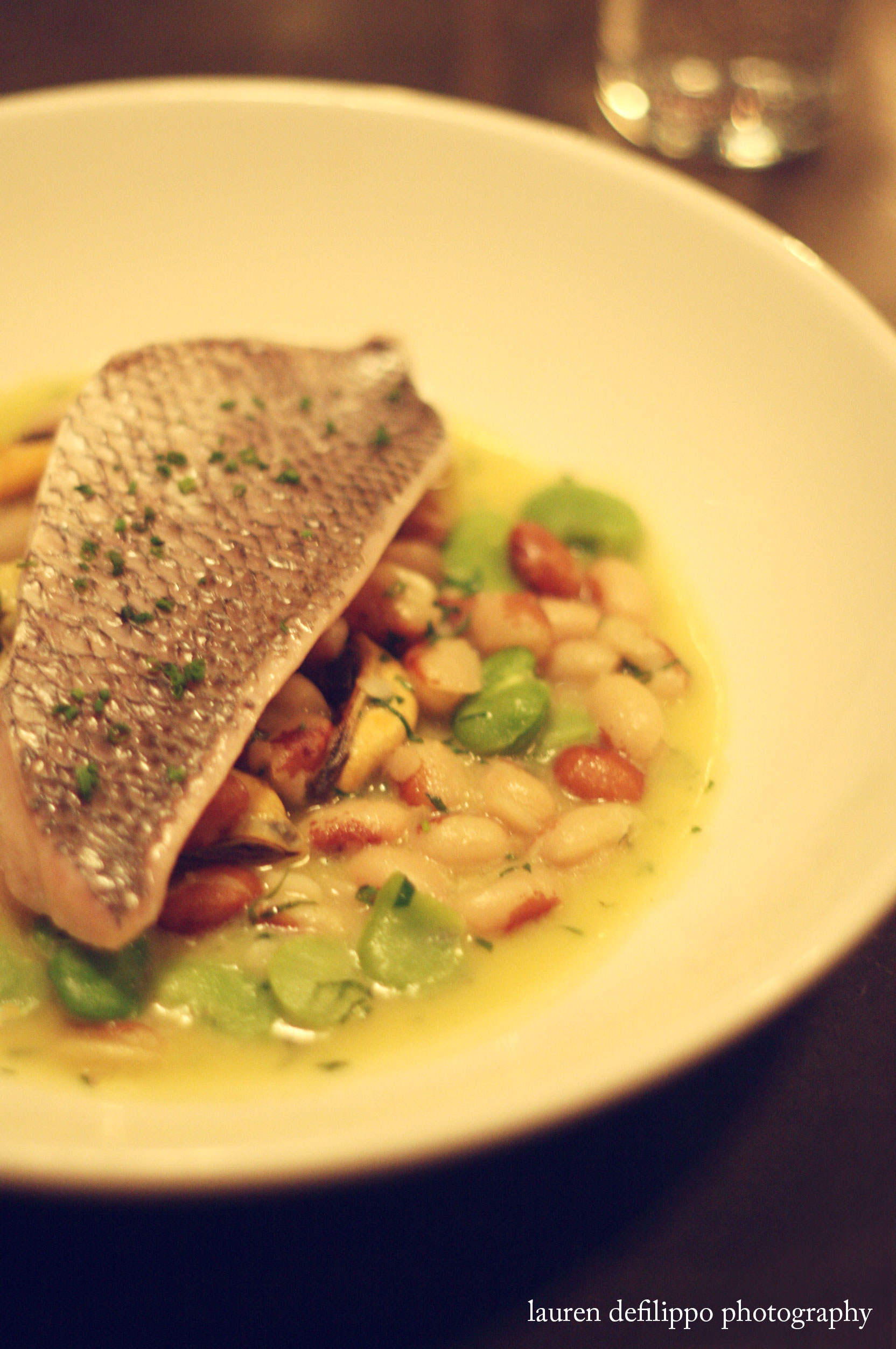 Porgy with fava and yellow eyed beans in green garlic broth