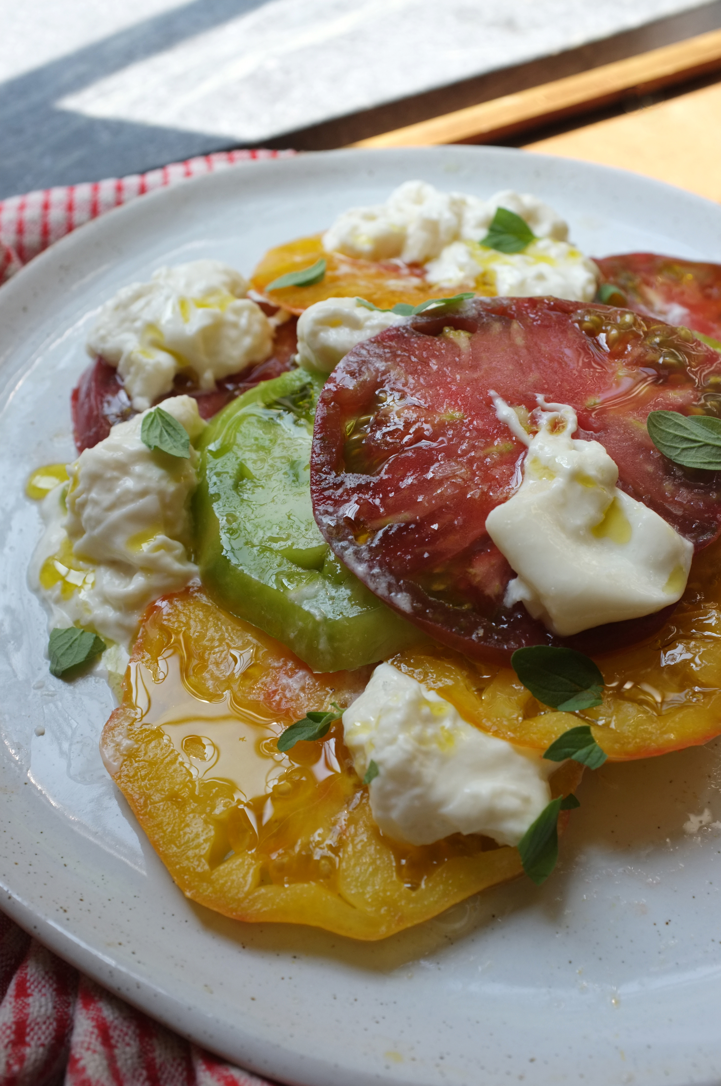 Fresh heirloom tomatoes with burrata, olive oil, oregano and Maldon salt.