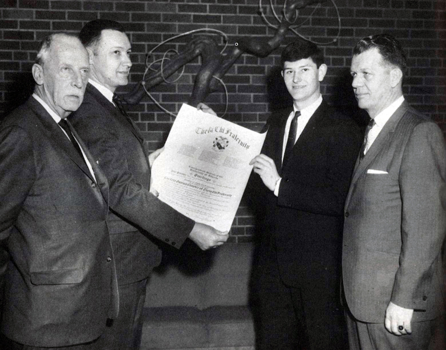Zeta Gamma receives Charter - (l-r): Executive Director George Chapman, National President Howard Alter, Beta Transfer Brother Donald Wismer, and National Vice President Mark McColm. McColm had traveled to Alberta at the request of George Chapman in February 1963 to meet with Alberta administrative officials and the IFC - February 20, 1965