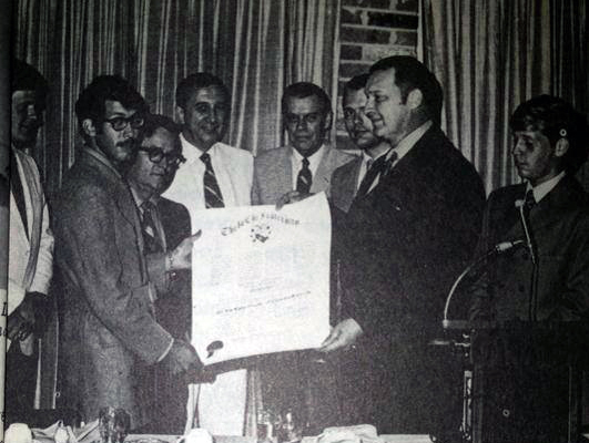 September 19, 1970 -  Eta Alpha Chapter at Clemson University installation with Executive Director Howard Alter presenting the charter to Eta Alpha's first Chapter President, Marc M. Feinberg (1971). Also present and providing remarks at the banquet was Major Elwood Fairbrother, (Alpha/Norwich 1960), a member of the Clemson Faculty as a Military Science teacher.