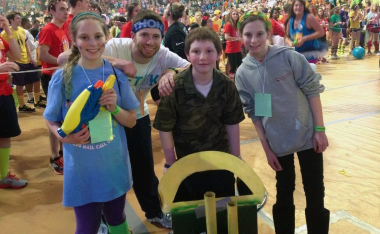 (From left) Alexis Bobby, 13, Ian Brodsky, AJ Bobby, 10, and Annabelle Bobby, 13, pose with the green tractor prop used in their Kid's Variety Show performance - THON 2014 - Feb. 22, 2014