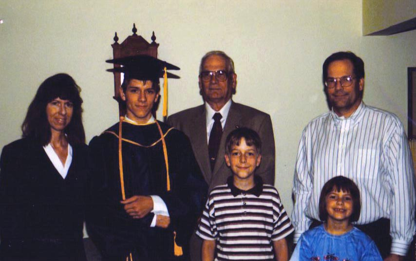 Bryan Powell '12 with his family, includ- ing his father Dan (Omega '81), now deceased.
