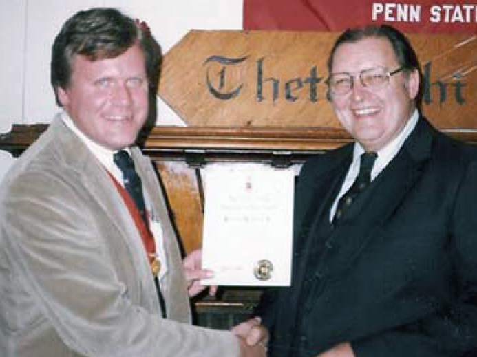 Associate Executive Director Dale Slivinske presenting Howard Alter with the Theta Chi for Life Award in 1983