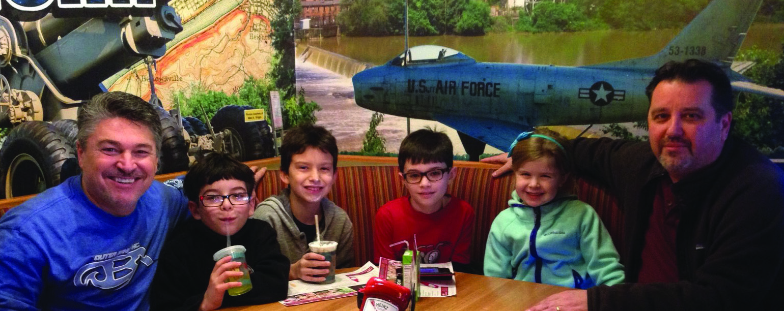 Brother Kidda (far right) and Brother Noll (far left) with Addyson, Joe's granddaughter (2nd from right), Julian Noll (3rd from right) and two of Julian's classmates after a Saturday morning Home Depot craft event, enjoying lunch at Applebee's.