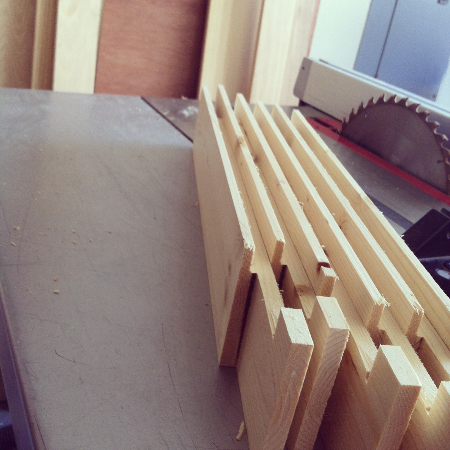 Freshly cut frame pieces, ready to be nailed and glued together.