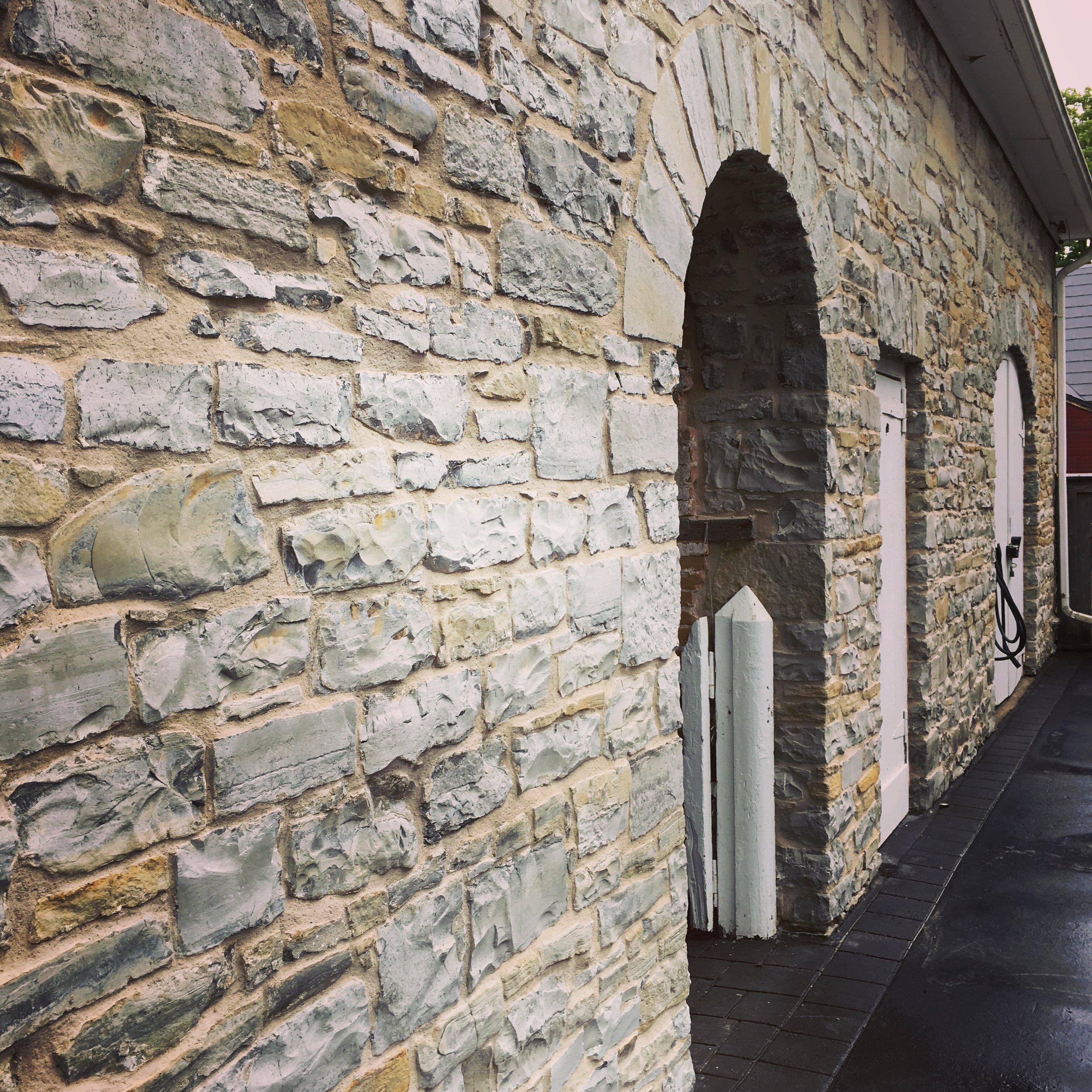 Repointed random rubble stonework