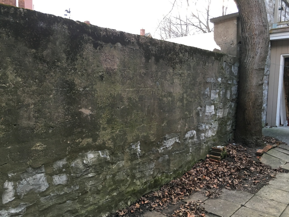 incompatible-repairs-to-limestone-wall