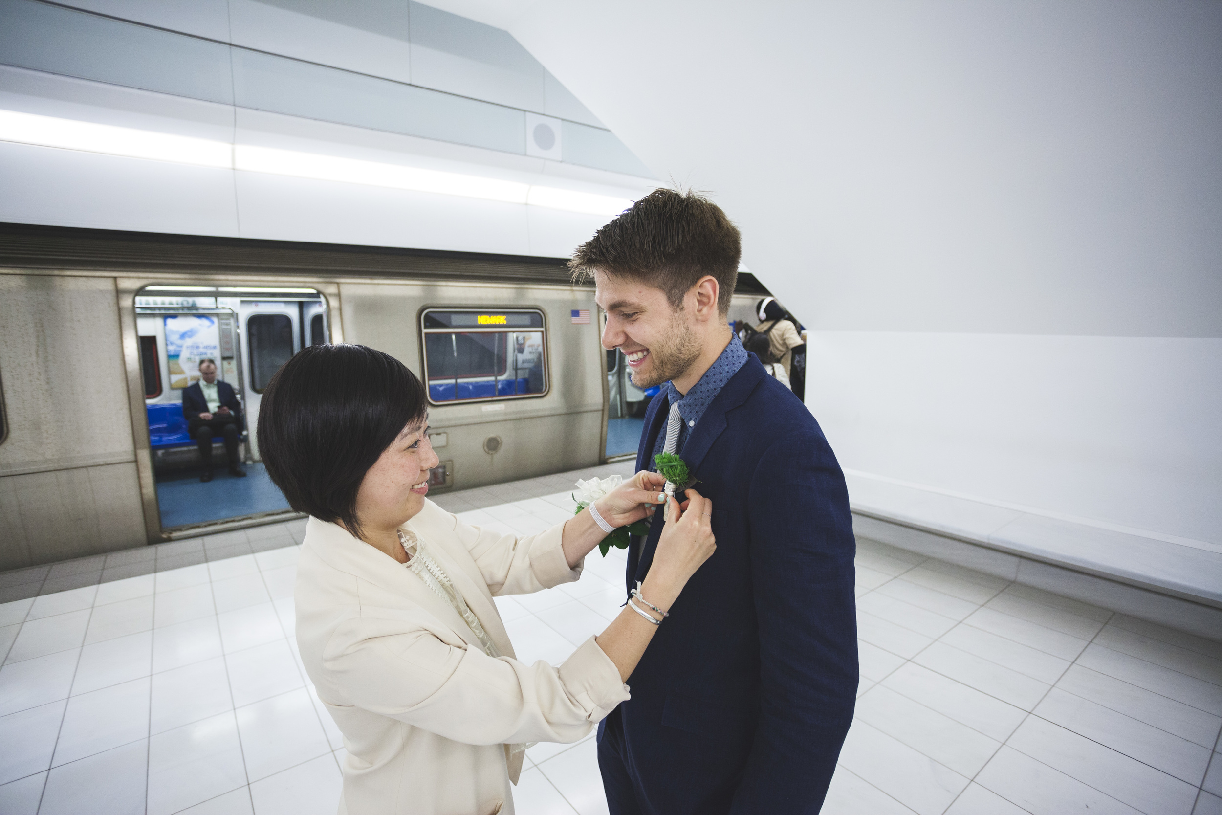 Getting the boutonnière ready in the train station!